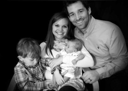 Black and white photo of couple with two kids