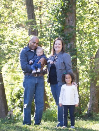 Couple with their two children posing in the woods