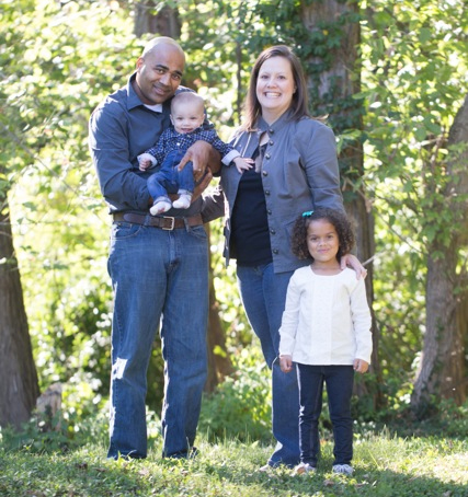 Photo of Massoni family standing in front of trees
