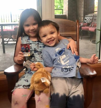 RMHC siblings with baseball card