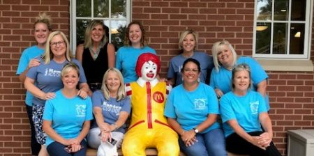 CBG Agents sitting on a bench with Ronald McDonald